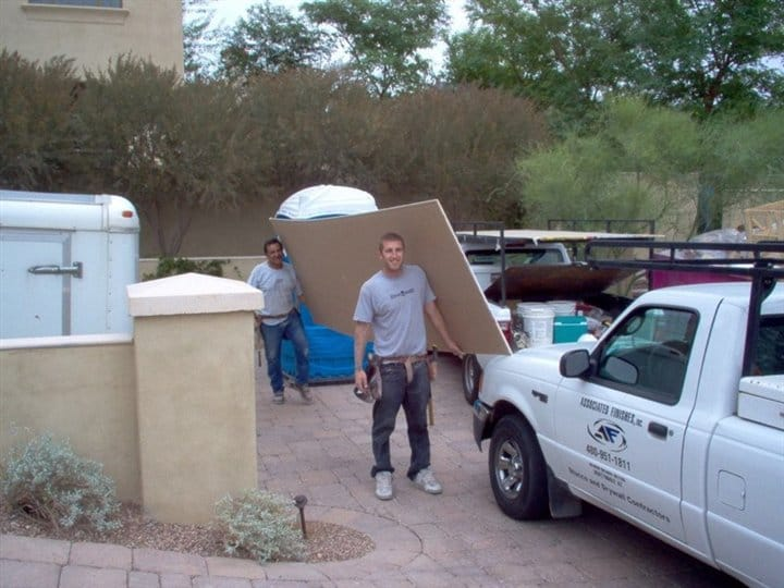 Men Carrying Drywall