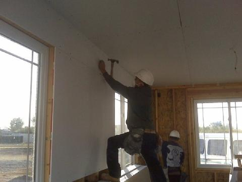 Man Nailing Drywall