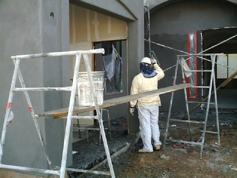 Man Working on a Stucco Wall